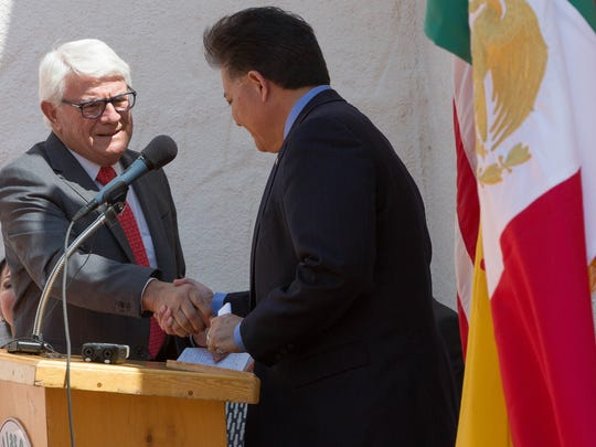 "Fred Mondragon, left, the honorary consul of Spain in Albuquerque, shakes hands with Ken Miyagishima, mayor of Las Cruces, before giving remarks about the ""Prado to the People"" traveling art exhibit that will be displayed near the Plaza de Las Cruces during a news conference at the Branigan Cultural Center Monday August 20, 2018."