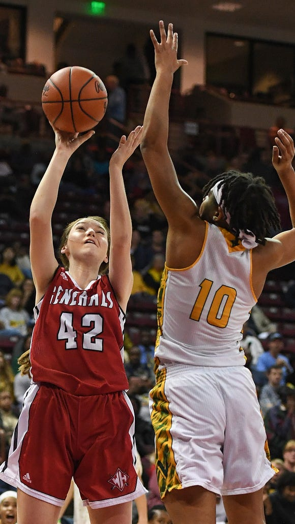 Spring Valley's Destiny Coleman (10) defends Wade Hampton's Brittany Shipman (42) during the Class AAAAA girls championship on Friday, March 2, 2018 at the Colonial Life Arena in Columbia.