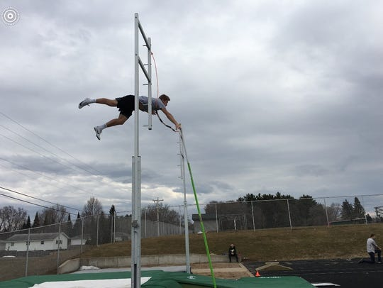 Kaleb Schuster clears the bar during a D.C. Everest