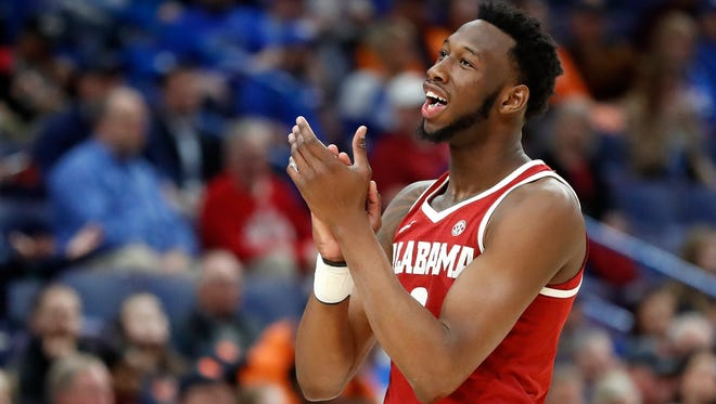 Alabama's Donta Hall celebrates during the second half in an NCAA college basketball quarterfinal game against Auburn at the Southeastern Conference tournament Friday, March 9, 2018, in St. Louis. Alabama won 81-63. (AP Photo/Jeff Roberson)