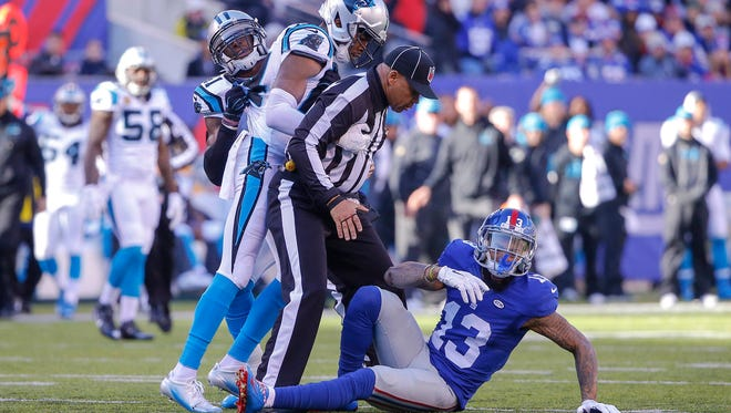 New York Giants wide receiver Odell Beckham (13) gets thrown to ground by Carolina Panthers cornerback Josh Norman (24) during the first quarter at MetLife Stadium.