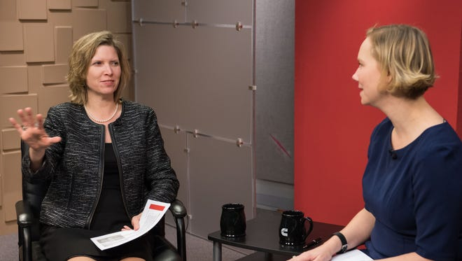 Jennifer Rumsey (left) talks with Tracy Embree  during a telecast to Cummins Inc. employees.