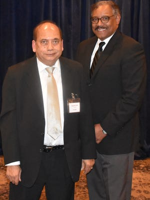 Dr. Dipak Das, left, was honored for 40 years of service by Peter Dews, MD, MS, FACP and members of the St. Mary Mercy Livonia medical staff.