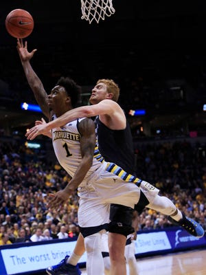 In this Feb. 2016 file photo, Creighton center Geoffrey Groselle fouls Marquette guard Duane Wilson.