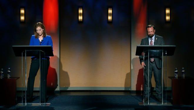 Rachel Barnhart and Harry Bronson debate at WXXI studios.