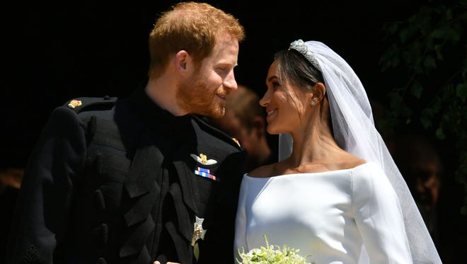 Just married! Prince Harry, Duke of Sussex, and wife Meghan, Duchess of Sussex, emerge from St. George's Chapel at Windsor Castle on Saturday after their wedding.