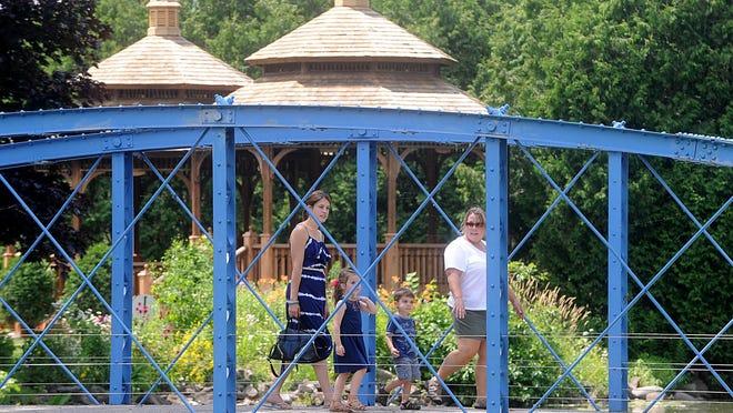 The historic blue Fountain Island Bridge