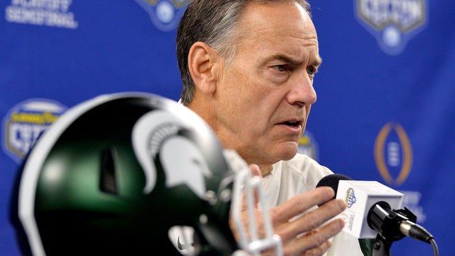 Coach Mark Dantonio talks to reporters during Cotton Bowl media day Tuesday.