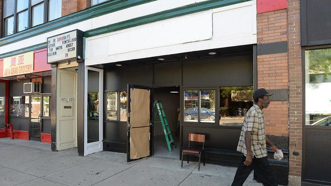 A pedestrian passes 1023 State St., where work is underway on a new restaurant on Thursday, in Erie. Pastor Curtis Jones, Sr., is the business owner and plans an August opening for the downtown spot called Chippers.