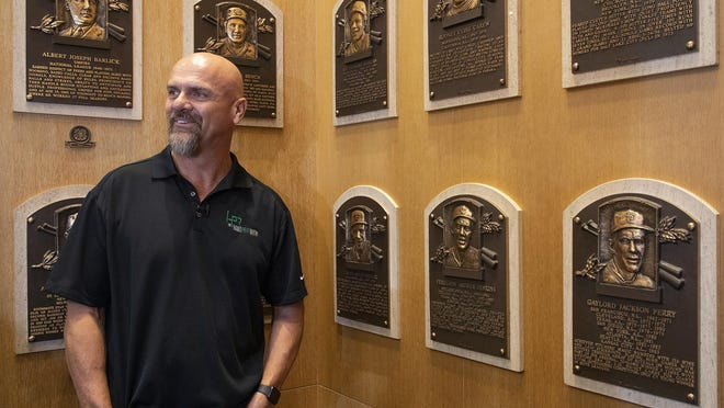 Larry Walker Larry poses near the wall of plaques at the National Baseball Hall of Fame in Cooperstown, New York, in February.