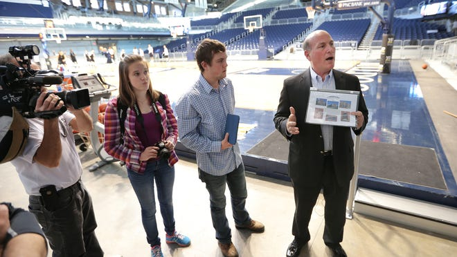 Ken LaRose, Butler University Associate Athletic Director of Development, shows some photos of what areas of Hinkle Fieldhouse received renovations during a tour of the fieldhouse on Thursday, Oct. 30, 2014.