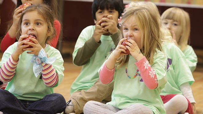 """In this file photo, the Madison YMCA Kirby Children's Center had an """"apple crunch,"""" as part of the YMCA Healthy U program and National Food Day."""
