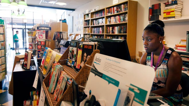 Yaya Traylor works at Ninth Street Book Shop on Market Street in Wilmington on Wednesday
