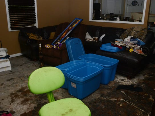 ANI Flooding Aftermath James and Chrystal Green's house, located on Roanoke Street off Prescott Road in Alexandria, sustained damage from Thursday's flooding. Many residents of houses located in neighborhoods off Prescott Road were cleaning up from floodin