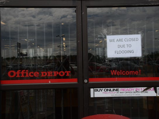 ANI Flooding Aftermath Office Depot, located right next to Ashley Furniture, was closed Friday due to flooding.-Melinda Martinez/mmartinez@thetowntalk.com