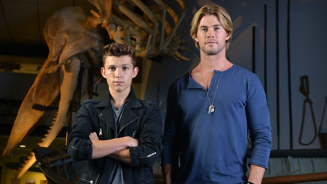 'In the Heart of the Sea' stars Tom Holland (left) and Chris Hemsworth pose in front of a sperm whale skeleton at the Nantucket Whaling Museum.