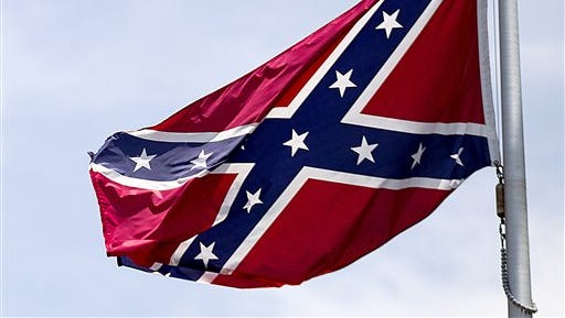 In this June 30 file photo, a Confederate flag flies at the base of Stone Mountain in Stone Mountain, Ga.