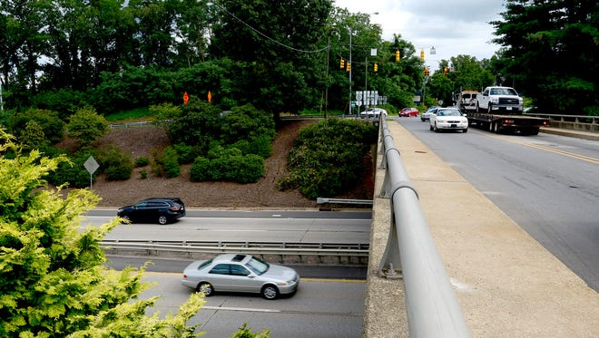 Traffic drives under the Brevard Road overpass on I-240 in West Asheville.