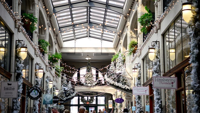 Shoppers explore the decorated Grove Arcade downtown on Wednesday, Nov. 23, 2016.
