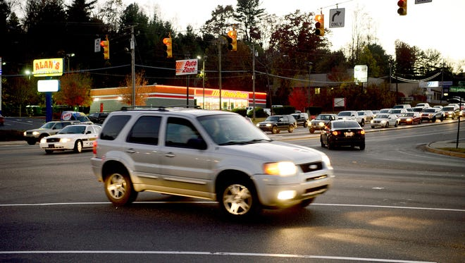 """Asheville does have """"smart"""" traffic lights on major corridors, including Patton Avenue, but more improvements are coming in 2017. In this photo, a vehicle turns on New Leicester Highway from Patton Avenue."""