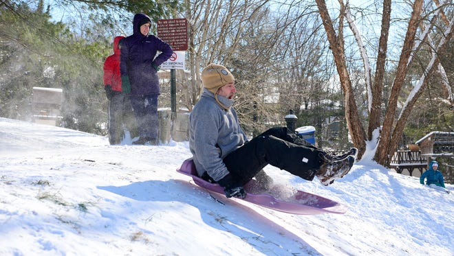Craig Lazara catches some air as he sleds down a hill behind the Montford Recreation Complex on Saturday, Jan. 7, 2017.
