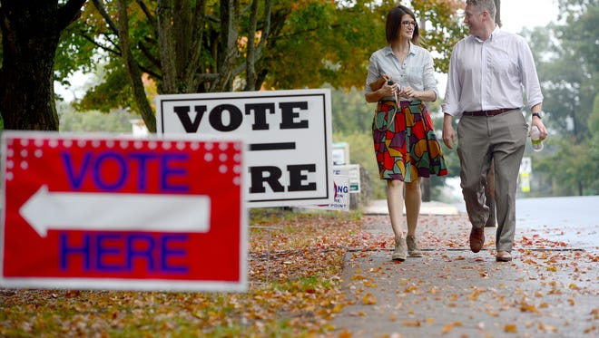 Mary Taylor and Brian Elston walk into the North Star Academy in Montford to vote in the Asheville City Council primary in October. A constitutional amendment on the Nov. 6 ballot to require photo identification to vote is one of the most hotly debated items on the 2018 ballot in North Carolina.
