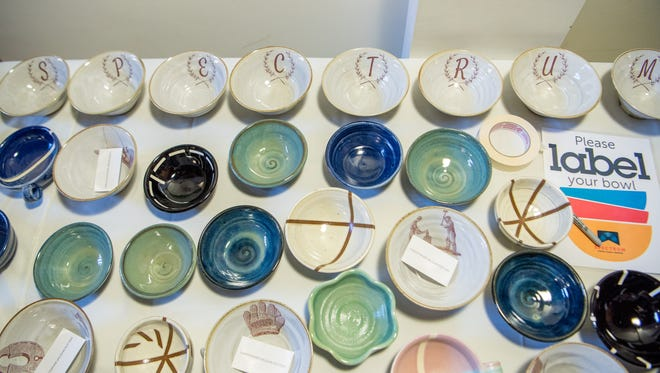 Bowls by local potters Jeremy Ayers, Chris Vaughn and Harold Kaplan are lined up for the annual Empty Bowl fundraiser for Spectrum Youth and Family Services in 2017.