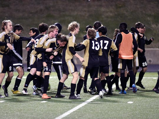 Rider celebrates after beating Denton Ryan 2-1 Monday, earning a 5-5A co-championship.