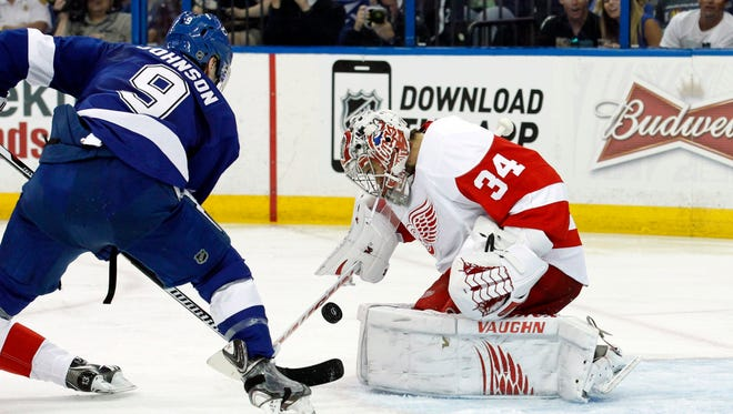 Tampa Bay Lightning center Tyler Johnson (9) shoots as Detroit Red Wings goalie Petr Mrazek (34) makes a save during the second period in game two of the first round of the 2015 Stanley Cup Playoffs at Amalie Arena. M