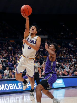 LSU guard Tremont Waters (3) drives to the basket past Furman guard Alex Hunter during the first half an NCAA college basketball game in Baton Rouge, La., Friday, Dec. 21, 2018. (AP Photo/Gerald Herbert)