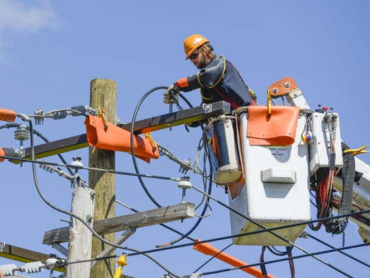 An Orange and Rockland Utilities lineman at work.