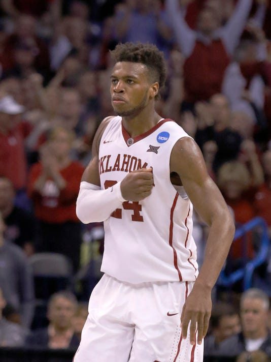 Oklahoma guard Buddy Hield (24) reacts after making a 3-point basket during the second half against Cal State Bakersfield during a first-round men's college basketball game in the NCAA Tournament in Oklahoma City, Friday, March 18, 2016. Oklahoma won 82-68. (AP Photo/Alonzo Adams)