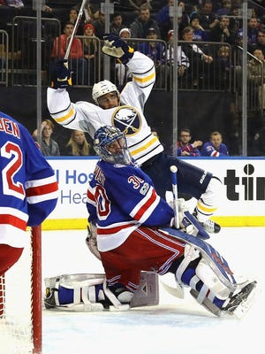 Evander Kane #9 of the Buffalo Sabres scores at 19:21 of the first period against Henrik Lundqvist #30 of the New York Rangers at Madison Square Garden on January 3, 2017 in New York City.