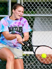 Katie Wagner, of Glen Rock, returns the ball to Dagney Markle, of New Oxford, during York City-County Tennis Tournament singles finals at Wisehaven Tennis Club in Windsor Township, Wednesday, June 28, 2017. Wagner would win two straight sets, 7-5 and 6-1, to win her second championship in three years. Dawn J. Sagert photo