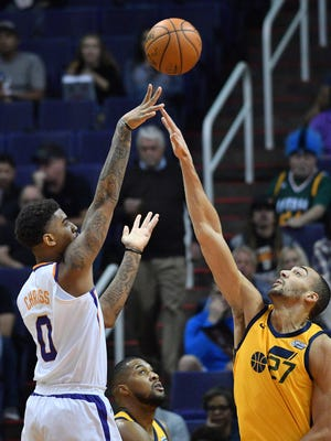 Feb 2, 2018; Phoenix, AZ, USA; Phoenix Suns forward Marquese Chriss (0) shoots over Utah Jazz center Rudy Gobert (27) during the first half at Talking Stick Resort Arena. Mandatory Credit: Joe Camporeale-USA TODAY Sports