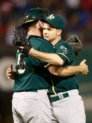 Oakland Athletics catcher John Jaso, left, congratulates starting pitcher Sonny Gray after the game against the Texas Rangers at Globe Life Park in Arlington.