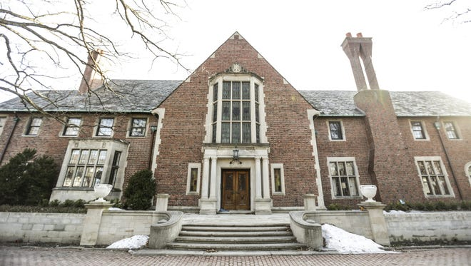 The Fisher Mansion in Detroit's Palmer Woods neighborhood sold for $1.6 million. A plan to convert the mansion into a dormitory for addiction treatment patients would be prohibited under current zoning rules.