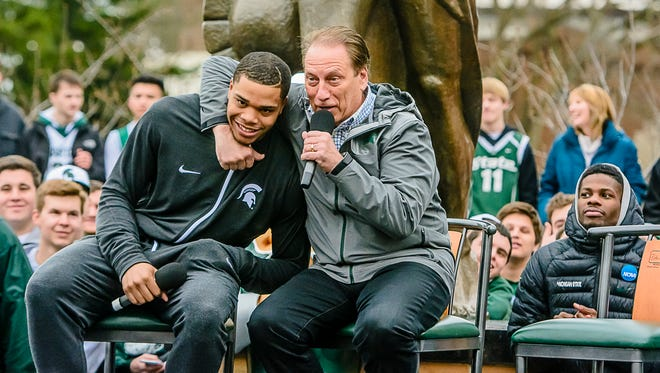 """I wish you would have told me that!"" MSU men's basketball coach Tom Izzo, right, puts MSU men's basketball player Miles Bridges in a head lock after Bridges informed the crowd that he had decided quite awhile ago that he was staying in school."