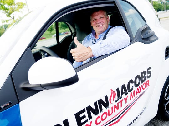 Glenn Jacobs poses for a photo in his Smart ForTwo Prime car during a campaign stop in Farragut on July 21. He's running for Knox County mayor.