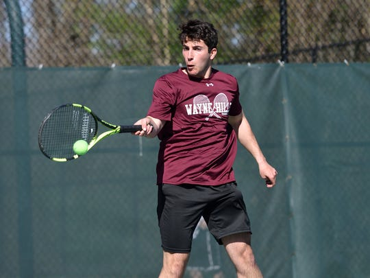 Sam Reyzelmar of Wayne Hills plays in the finals of Passaic County boys tennis tournament at West Millford High School