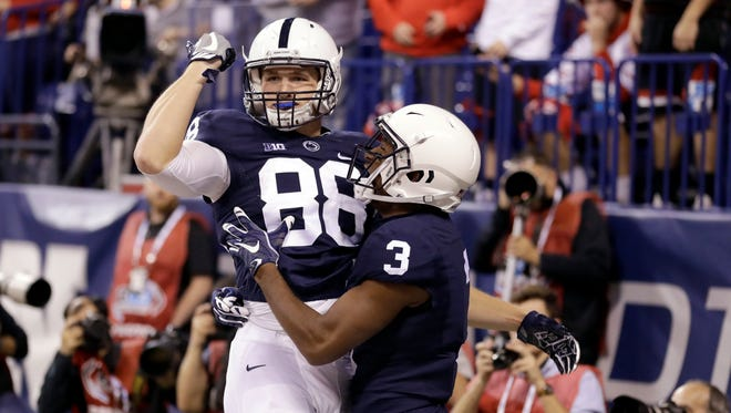 Penn State's Mike Gesicki (88) celebrates with DeAndre Thompkins (3) after Gesicki made a 33-yard touchdown reception during the first half of the Big Ten championship NCAA college football game against Wisconsin, Saturday, Dec. 3, 2016, in Indianapolis. (AP Photo/Michael Conroy)