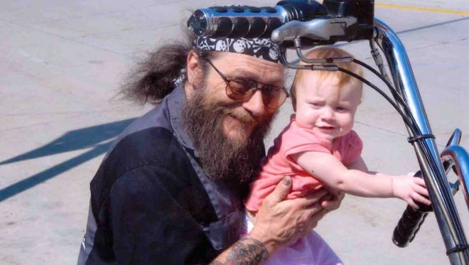 Michael L. Funk, shown here holding one of his  granddaughters, was killed by police during a hostage standoff in Neenah.