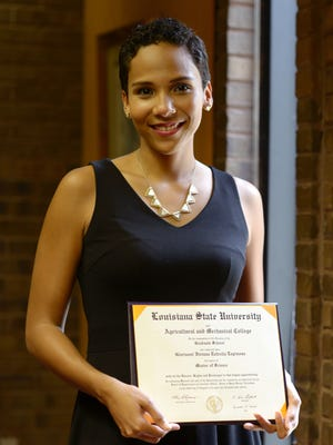 Glorianni Estrella Espinosa, who recently graduated from LSU with a master's degree in agricultural economics, poses with her diploma on Aug. 5, 2016. She is from the Dominican Republic and was able to study at LSU through a scholarship program funded by that country's higher education ministry.