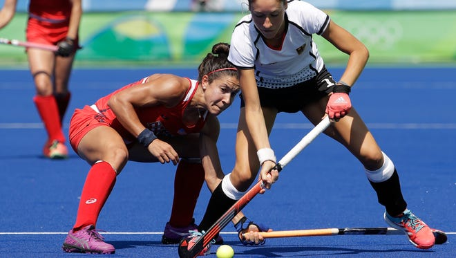Germany's Eileen Hoffmann, right, fights for the ball with United States' Melissa Gonzalez, left, during a women's field hockey quarterfinal match at the 2016 Summer Olympics in Rio de Janeiro, Brazil, Monday, Aug. 15, 2016. Germany won 2-1.