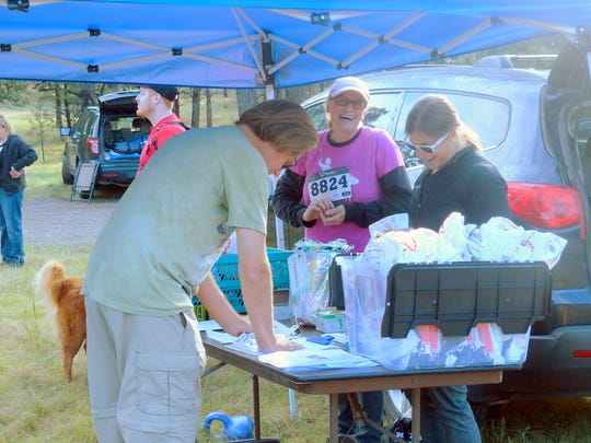 A walker signs in at the Wandering Paws event Saturday.