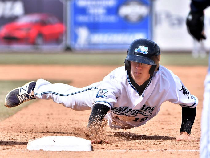 West Michigan Whitecaps shortstop Cole Peterson dives