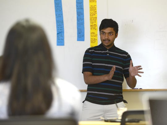 Arav Agarwal, of the International Academy, Okma, discusses his innovative idea to reduce lead levels in water for Flint residents during a collaboration between Workforce Software and GENYOUth.