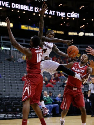 Arizona State guard Gerry Blakes (4) looks to pass the ball between Alabama forward Jimmie Taylor (10) and Levi Randolph (20) in the consolation game of the CBE Hall of Fame Classic Tuesday, Nov. 25, 2014, in Kansas City, Mo.
