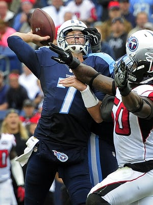 Titans quarterback Zach Mettenberger is hit in the face by a Falcons defender and throws an interception late in the second quarter.