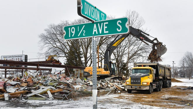 Demolition is almost complete between 19 1/2 Avenue South and Cooper Avenue along Division Street. Shown Monday, Feb. 19, the block is being cleared for redevelopment.